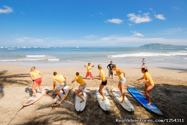 Students taking surf lessons - Learn Spanish at beautiful Tamarindo Beach