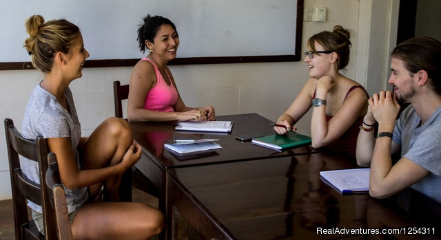 Teacher with students - Learn Spanish at beautiful Tamarindo Beach