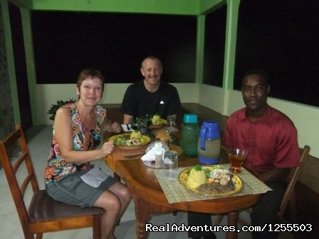 Guest having dinner with Owner - Affordable vacation in Dominica