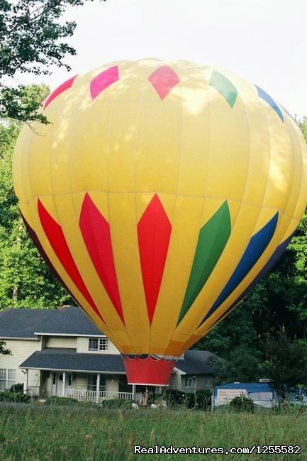 Inflated next to gracious homeowner | Image #2/7 | Magic Carpet Ride Balloon Adventures