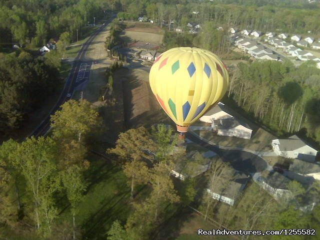 Flying low over neighborhood looking for landing spot (#4 of 8) - Magic Carpet Ride Balloon Adventures