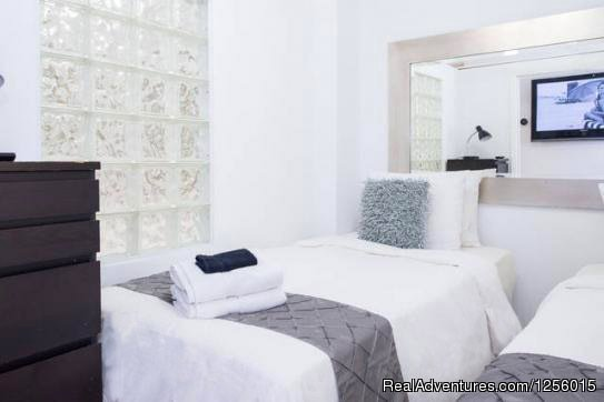 Bedroom 2 with 1 King or 2 Twins | Image #8/9 | 3 Room Art Deco Oceanfront Suite at Shelborne