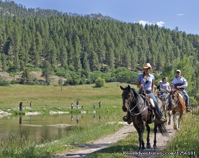 Adults on a lunch ride and kids fishing in one of our ponds - Colorado Trails Ranch, Colorado's Friendliest
