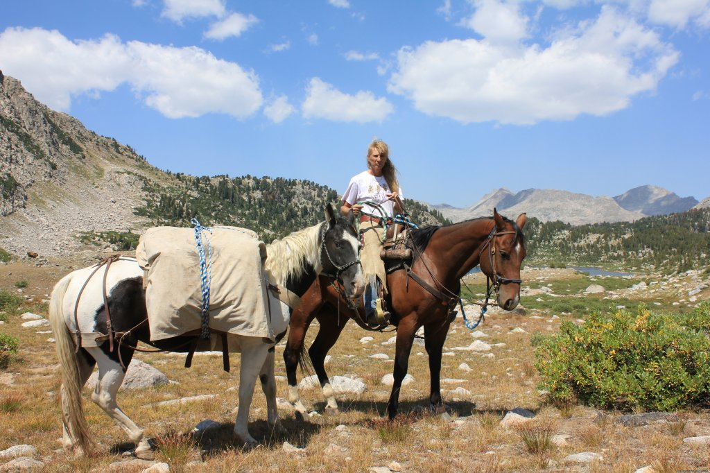 Sandy with pack horse | Image #13/22 | Mule Shoe Outfitters