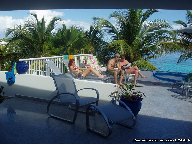 An incredible location on a gorgeous sandy beach, this magnificent ocean front house has a large pool and huge patio.  