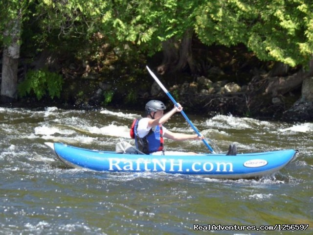 Raft NH Guest Playing In A Duckie (Inflatable Kayak) - Muddy Paw Sled Dog Kennel & Raft NH