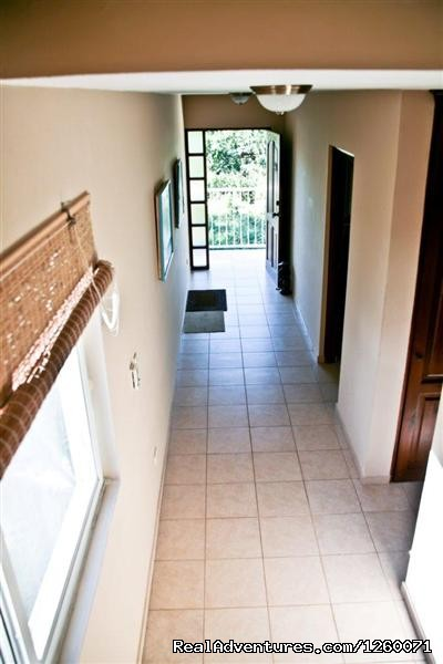 Entrance hall with wide 4' hallway - Beachside Vacation Getaways at Vecinos