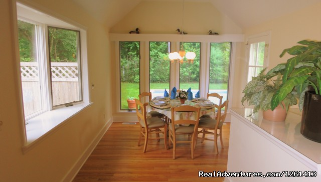 Dining room with view of swimming pool (seats 6). - Charming & Private - Heart of East Hampton Village