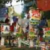 A mixture of Tibetan prayer flags and Korean lanterns near t