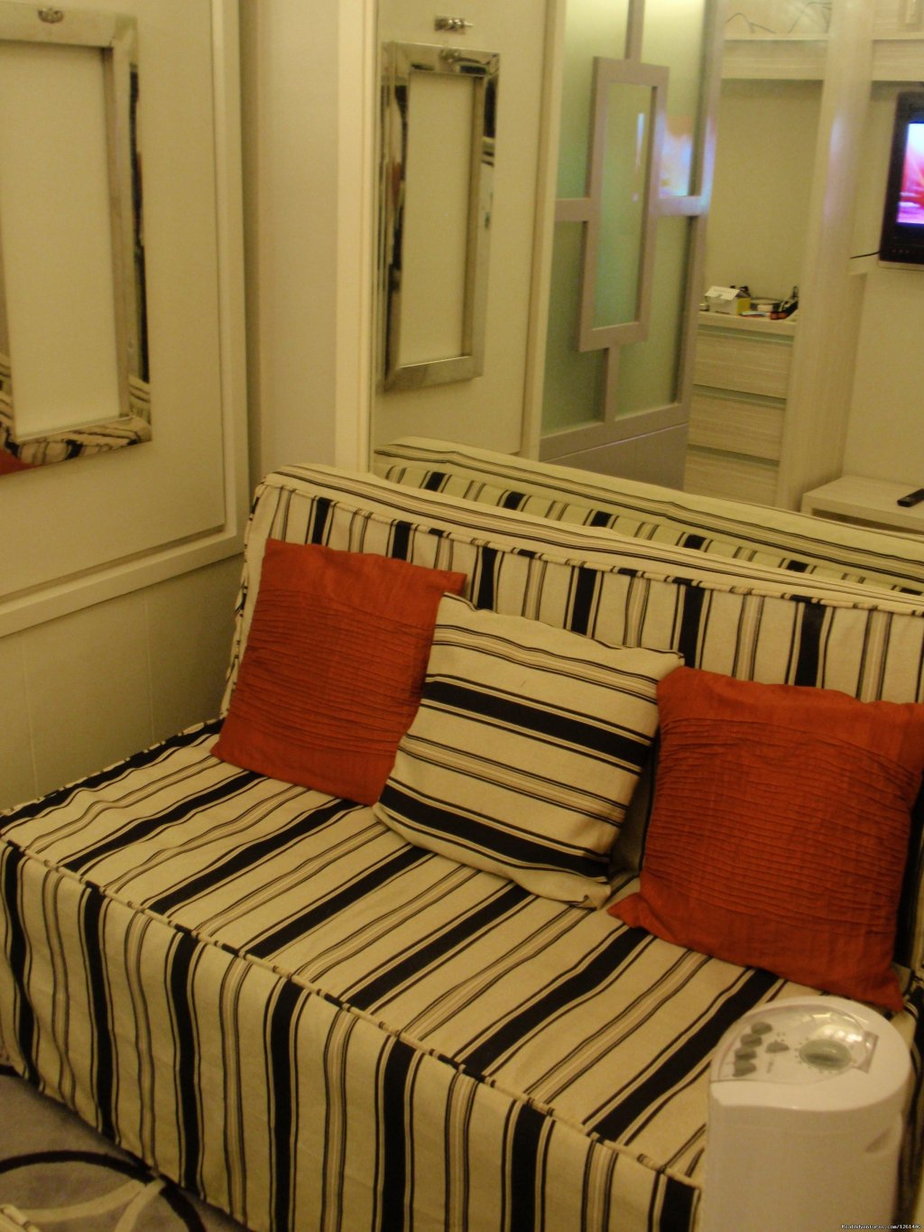Living Area And Love Seat | Image #22/26 | Fully Furnished Studio-Condo Unit in Manila