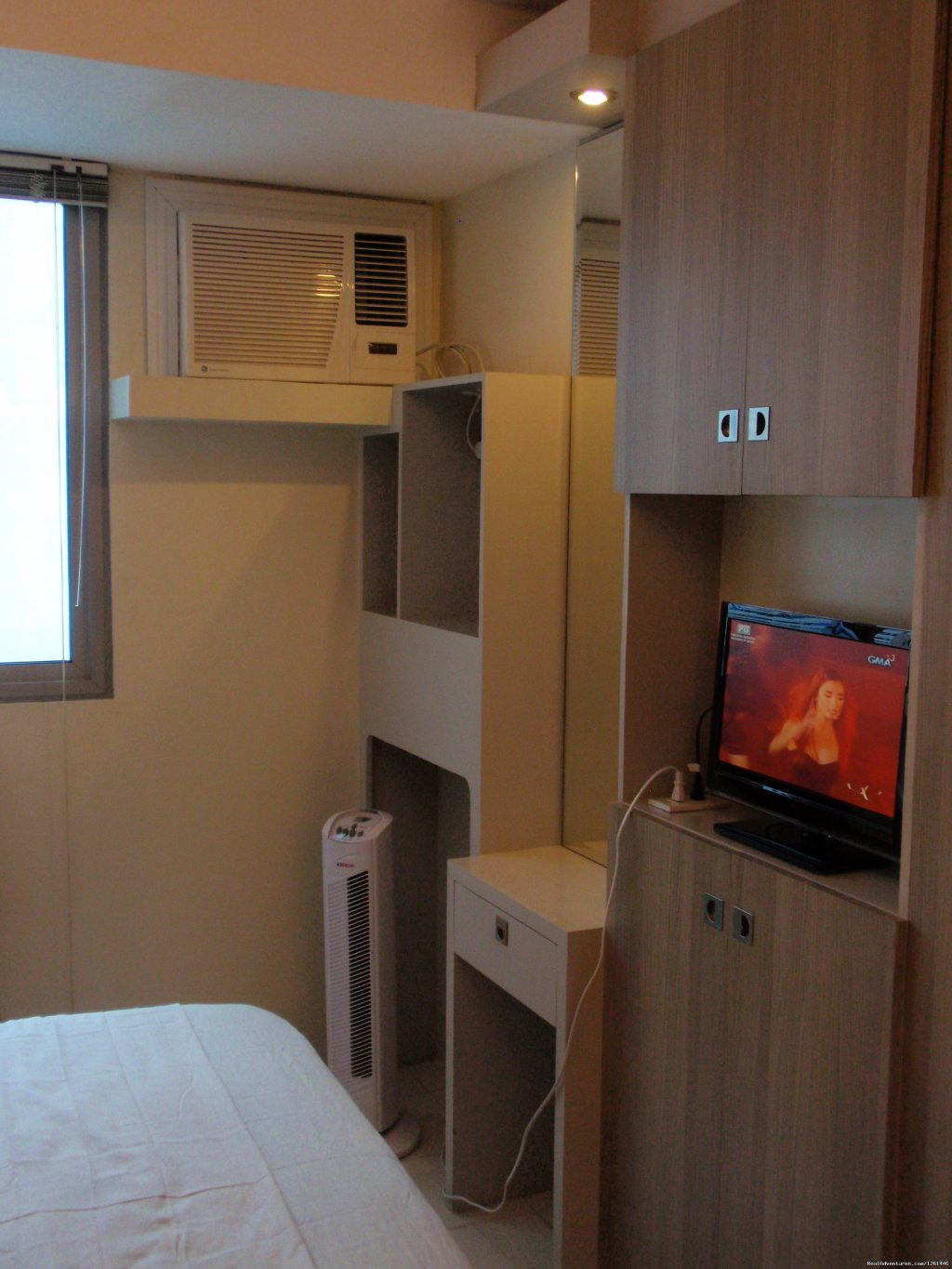 25th floor unit TV, vanity area. | Image #17/26 | Fully Furnished Studio-Condo Unit in Manila