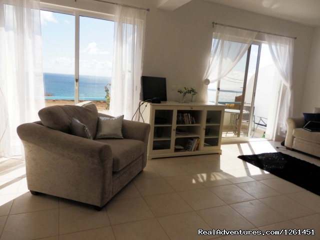 Living room with ocean view - Sao Vicente Tranquil Beach House