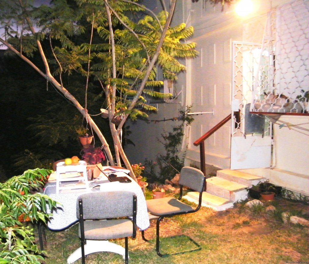 At Nights: Out Door Yard With A Table And Chairs | Image #13/17 | Stella- Maris Hosting: Vacation  Rental
