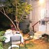 At Nights: Out Door Yard With A Table And Chairs