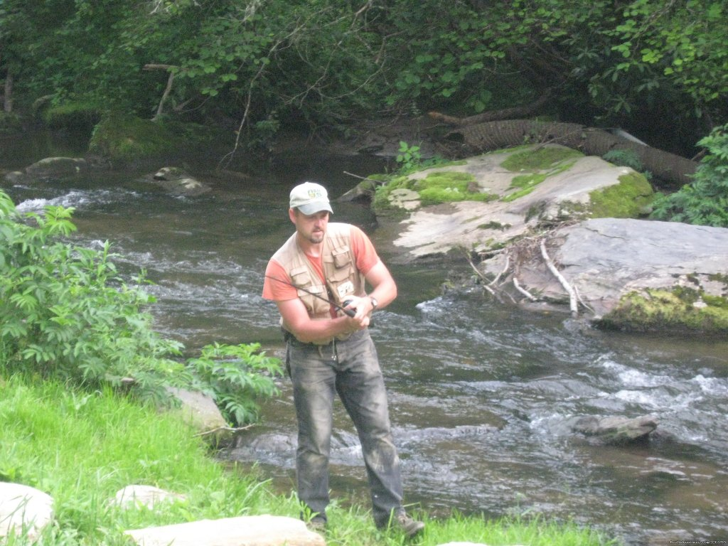One of our guest fly fishing | Image #4/20 | Luxury Cabin on Beautiful Mt Stream $199/nightly