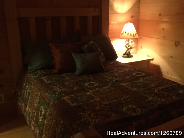 Chair under the stairs for reading/relaxing (#14 of 22) - Luxury Cabin on Beautiful Mt Stream Great Rates