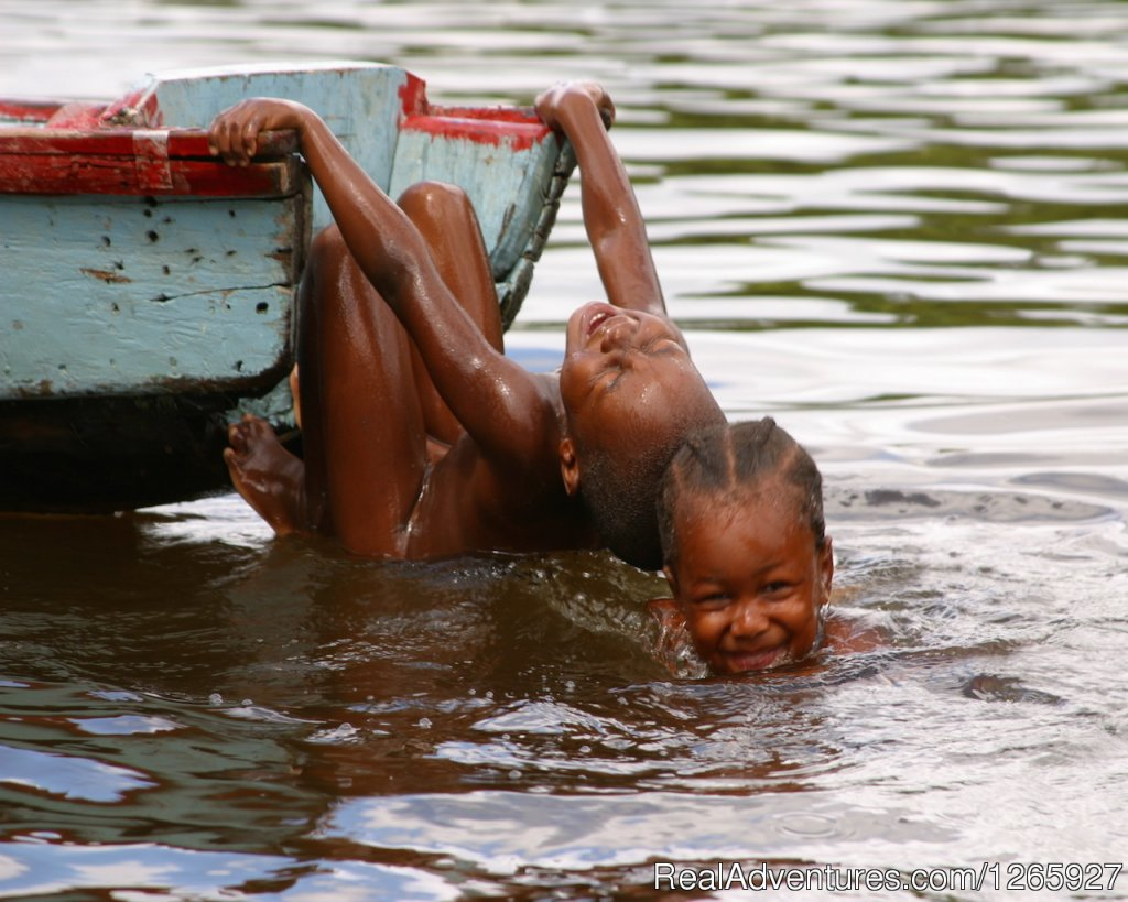 The maroon culture in Suriname, happy children swimming | Image #2/8 | Suriname, a melting pot of cultures and heritage
