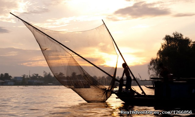 Fisherman at dusk on the Mekong river, Vietnam. - Cruise The Magnificent Mekong: Saigon - Phnom Penh