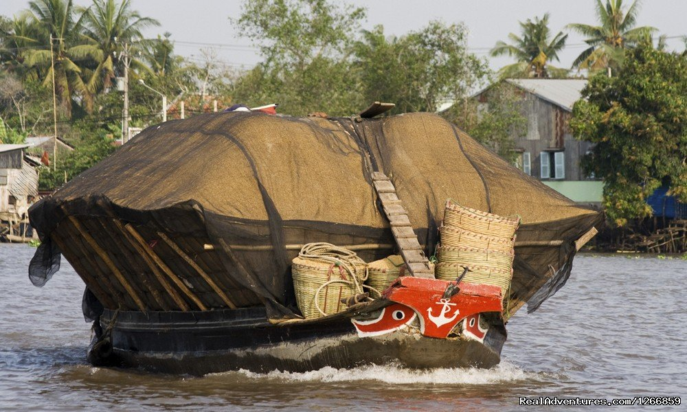 Vietnam Boat Loaded With Rice Vietnam | Image #2/6 | Cycle Of Life: Explore The Mekong By Bike