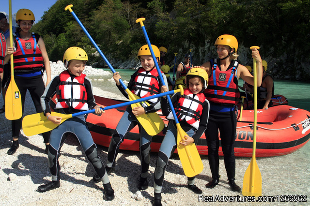 Family rafting - Rafting on the emerald Soca river, in Slovenia