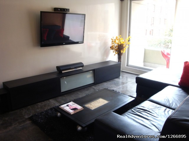 TV living room - Modern Furnished Apartment In Zona Rosa Bogota