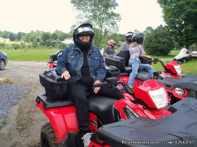 Happy Rider - NEK Adventures Snowmobile Rentals &  ATV tours