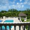 Guest suite Balcony ocean, pool, & garden view