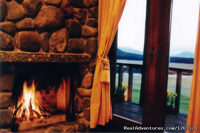 Log Fire in the Traditional Chalets - Exclusive Rental Luxury Lodge & Retreat