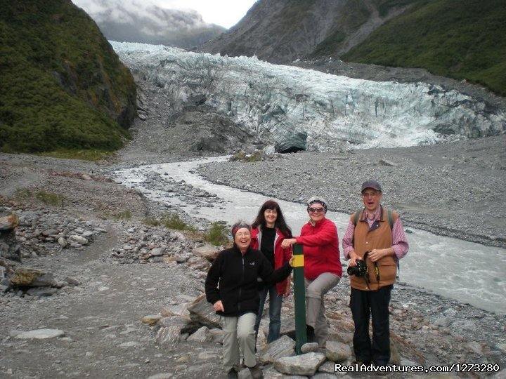 A group enjoys a photo in front of Fox Glacier | Image #13/19 | Self Drive and Guided New Zealand Tours