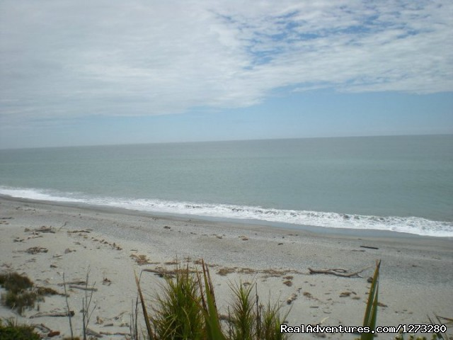 A deserted beach near Haast - Self Drive and Guided New Zealand Tours