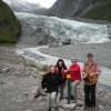 A group enjoys a photo in front of Fox Glacier