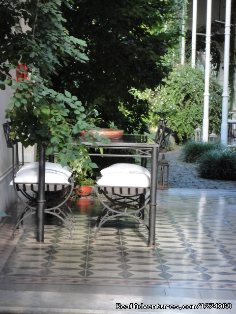 Gallery with table and chairs in the lovely garden (#24 of 26) - Charming Home Buenos Aires