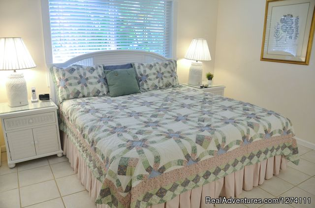 Standard size one-bedroom apartments have king beds - Sunny Place - A short walk to the beach