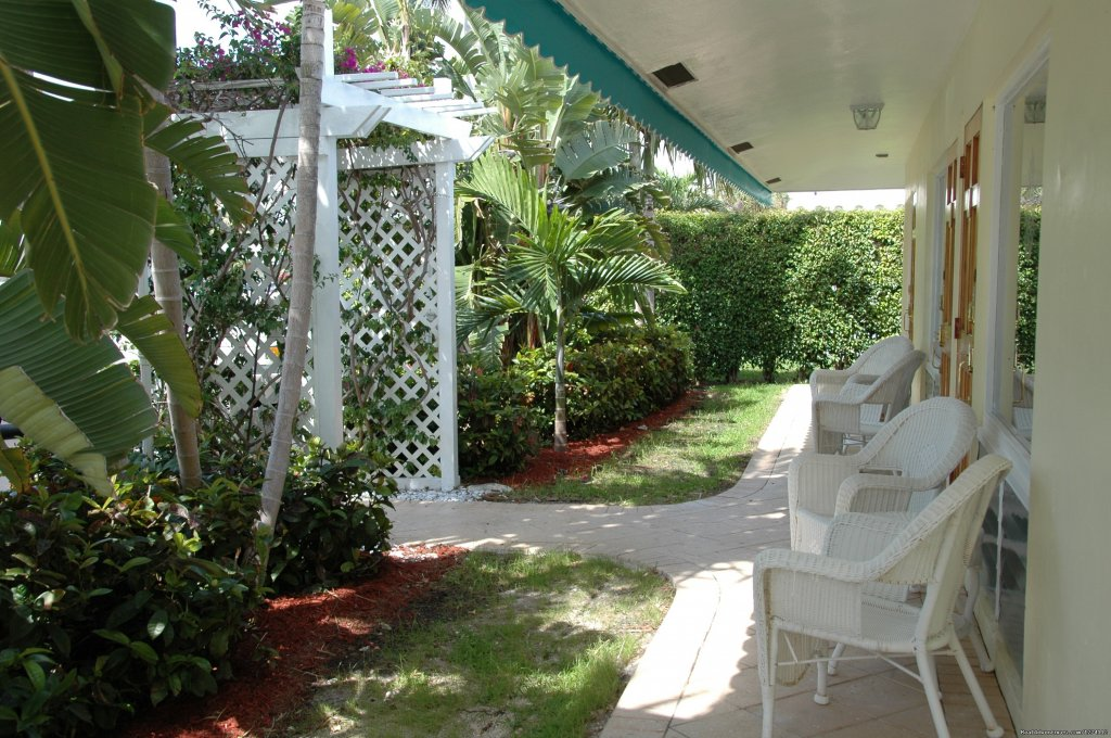 Enjoy the veranda to read a book or have morning coffee. | Image #3/26 | Pineapple Place - South Florida great getaway