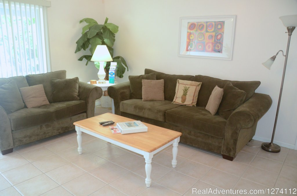 Living room of 1/1s and 2/2 with queen sleeper | Image #7/26 | Pineapple Place - South Florida great getaway