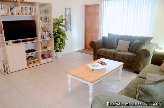 Living room of 1/1s and 2/2 with queen sleeper - Pineapple Place - South Florida great getaway