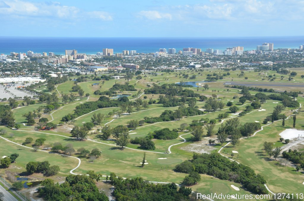 Greg Norman golf course on the city's municipal facility | Image #22/25 | Yacht and Beach Club - Waterfront Condo