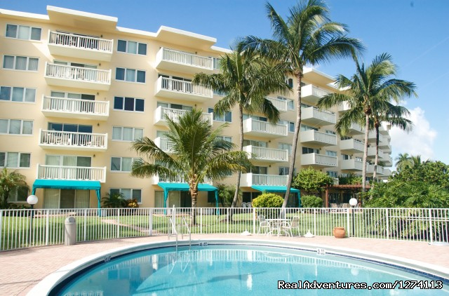 Heated pool in backyard - Yacht and Beach Club - Waterfront Condo
