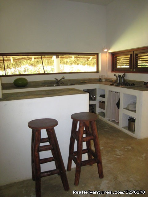 Kitchen in living room - La Cueva eco-lodge Las Galeras