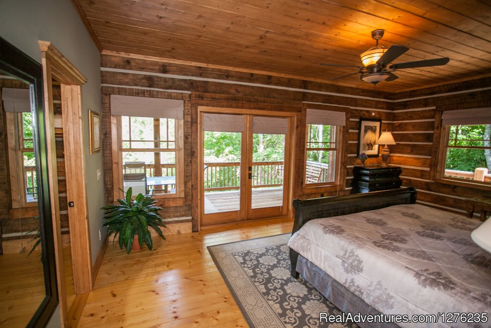 King Master with double doors out to deck | Image #7/22 | Luxury Wildflower Cabin in the Woods, Franklin NC