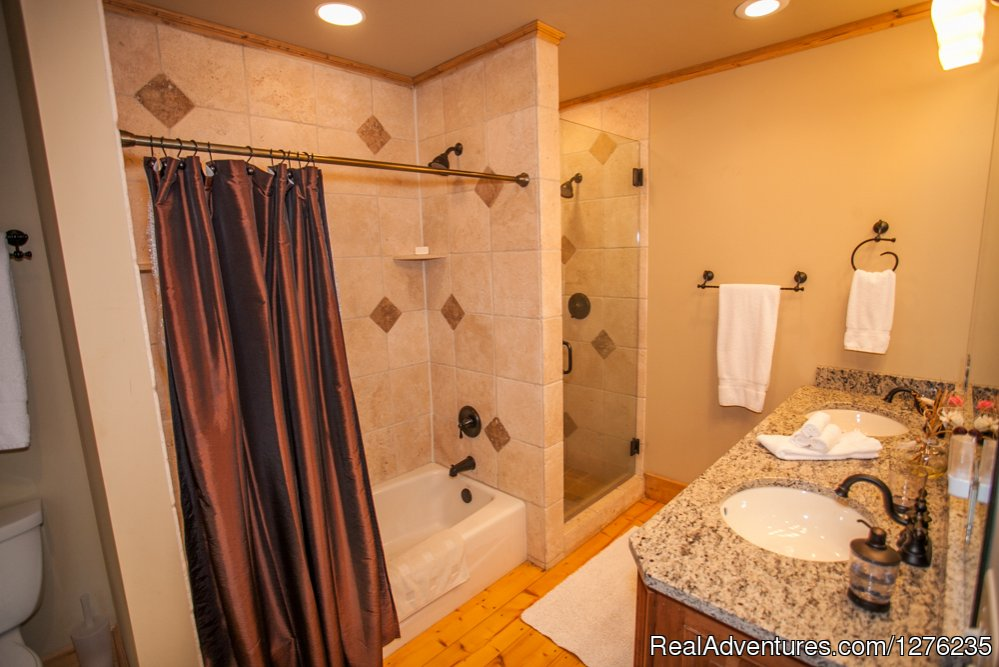 Master Bath with double sinks, shower & tub/shower | Image #10/22 | Luxury Wildflower Cabin in the Woods, Franklin NC
