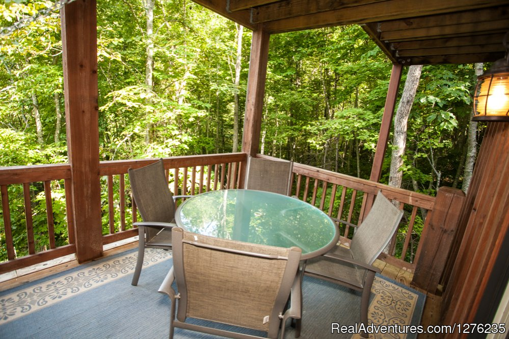 Lower deck sitting | Image #19/22 | Luxury Wildflower Cabin in the Woods, Franklin NC