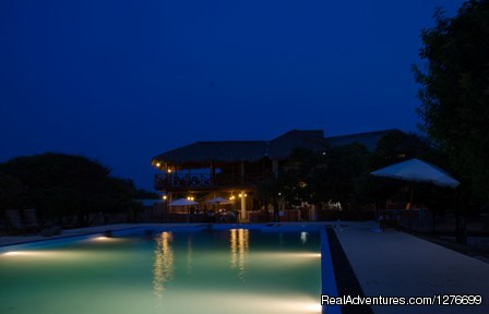 Night View of the main pavilion across the pool. - Hotel and Eco Resort with Beach chalets