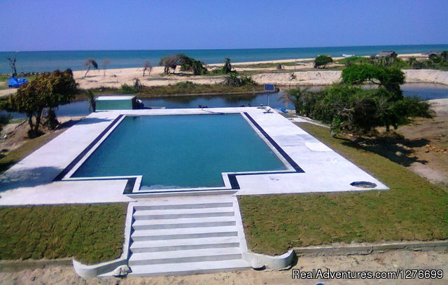 Pool and sea view from upper deck Cofee shop. - Hotel and Eco Resort with Beach chalets