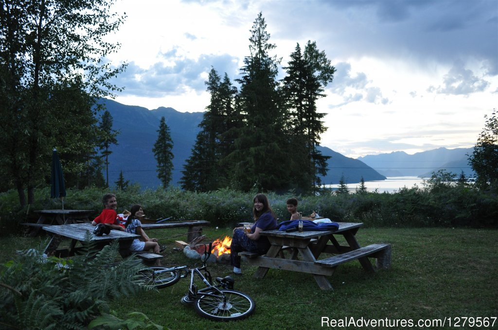 Fire pit in front of cottage | Image #8/12 | Blue Sky Resort log-cottages , lake view