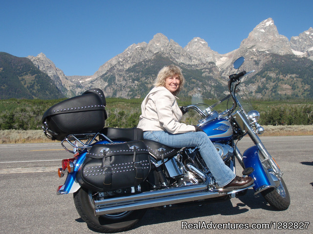 A photo stop at the base of The Grand Tetons. - Luxury Custom Motorcycle and Sports Car Tours