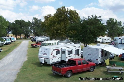 Full service Camp ground with Tenting, RV Sites, Cabins, RV Storage, Store, Pool, Wi-Fi, Cable TV, Fax service, Game Room, Showers, Laundry, Meeting room/Rec. Hall, Playground, and coming soon