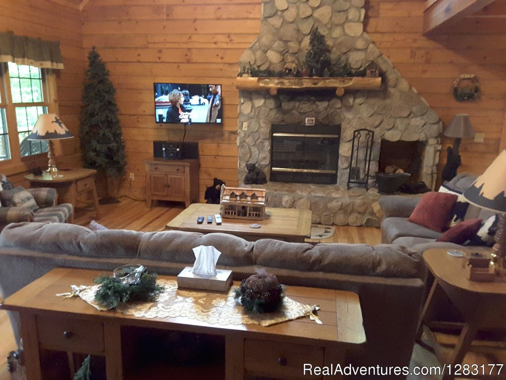 Great Room with Two Story Stone Wood-Burning Fireplace