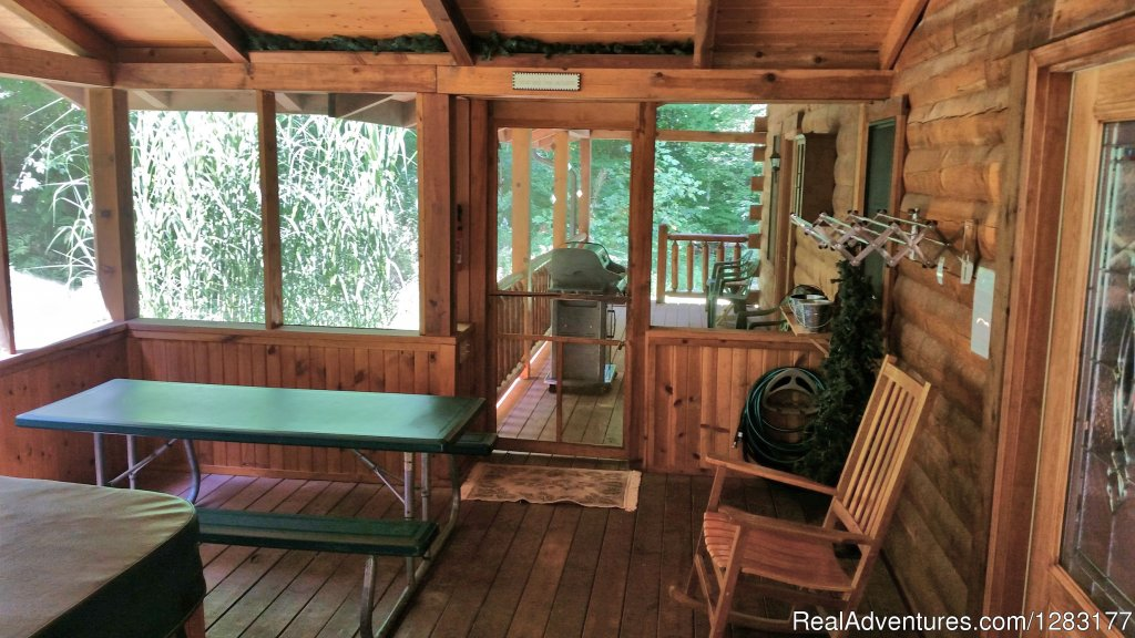 Screened in Hot Tub Porch Adjoins the Back Deck | Image #19/26 | Adventurewood Log Cabin HotTub/Fireplace/PoolTable