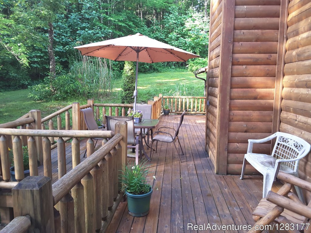 Relax with Friends on the Sun Deck | Image #17/26 | Adventurewood Log Cabin HotTub/Fireplace/PoolTable